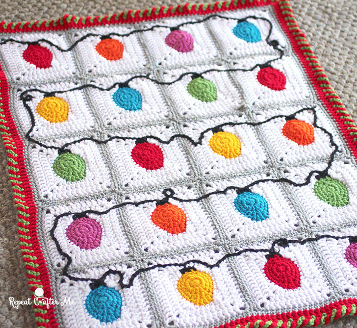 Get the Pattern (and video tutorial!) for the Christmas Lights Granny  Squares in THIS POST - Crochet Christmas Lights Blanket - Repeat Crafter Me