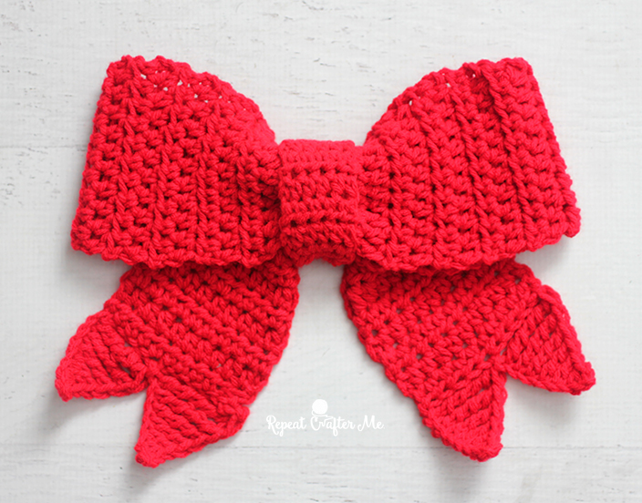27fe2502622ca6 Big Red Bows make festive decor during the holiday season and now you can  crochet one! Hang it on your door, wreath, tree, packages, and more!